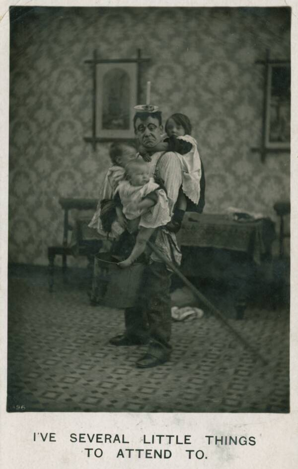 Man In An Apron Holding Children
