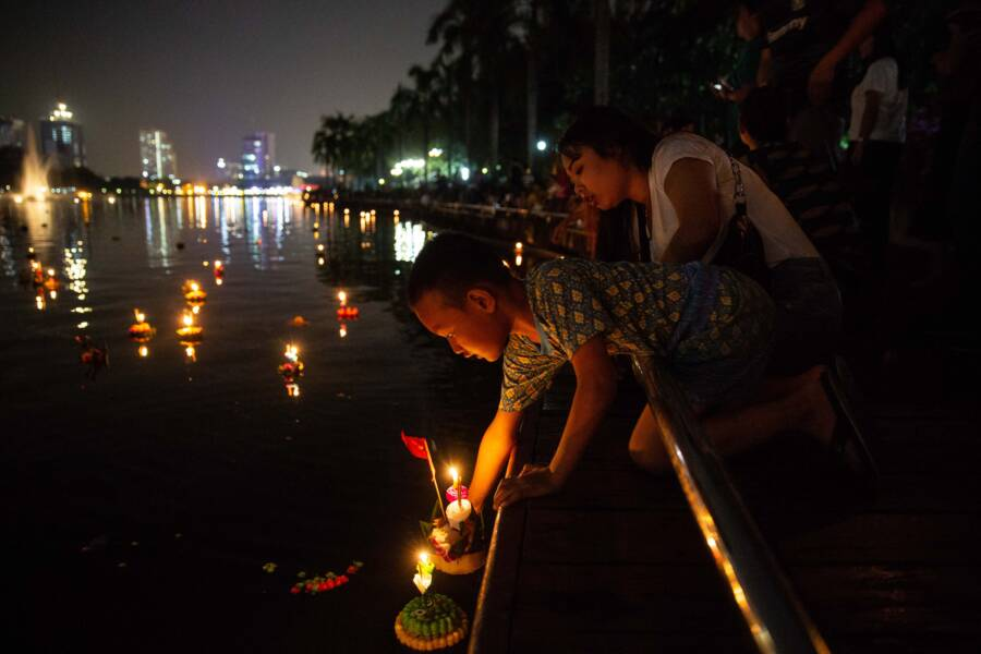Boy Puts Down Loy Krathong Offering