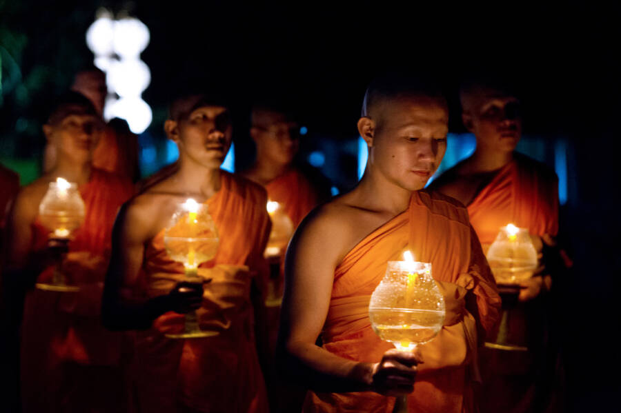 Buddhist Monks Hold Light