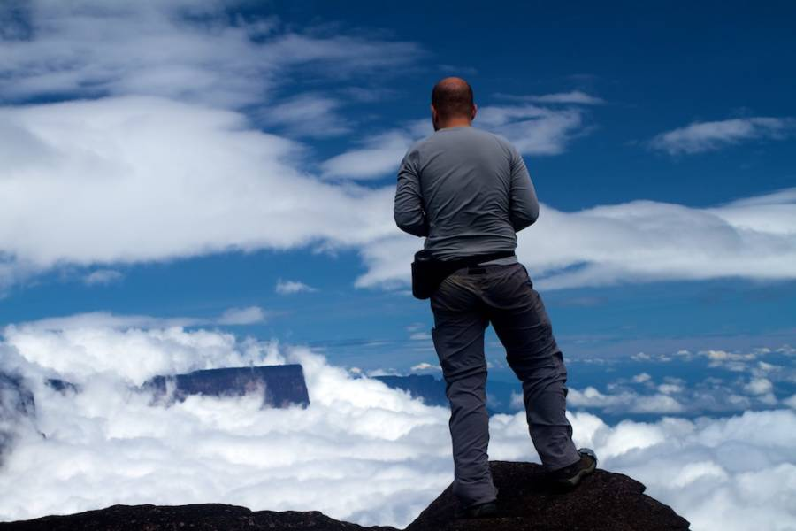 Man Looking At Clouds