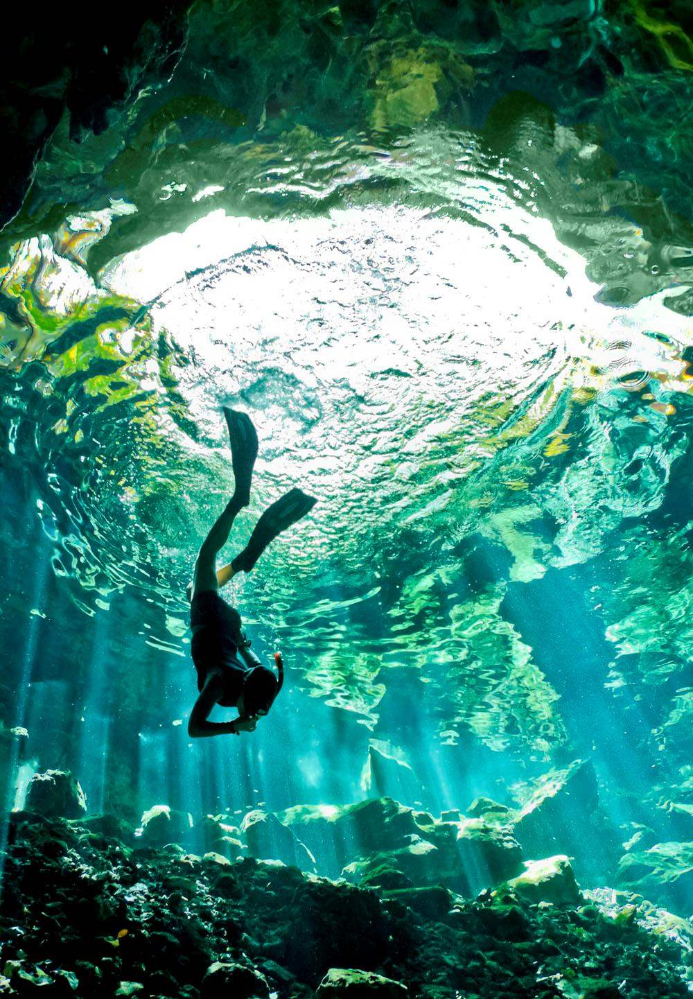 Diving Into A Cenote