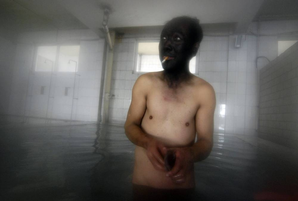 A Coal Miner Bathes In Changzhi, China