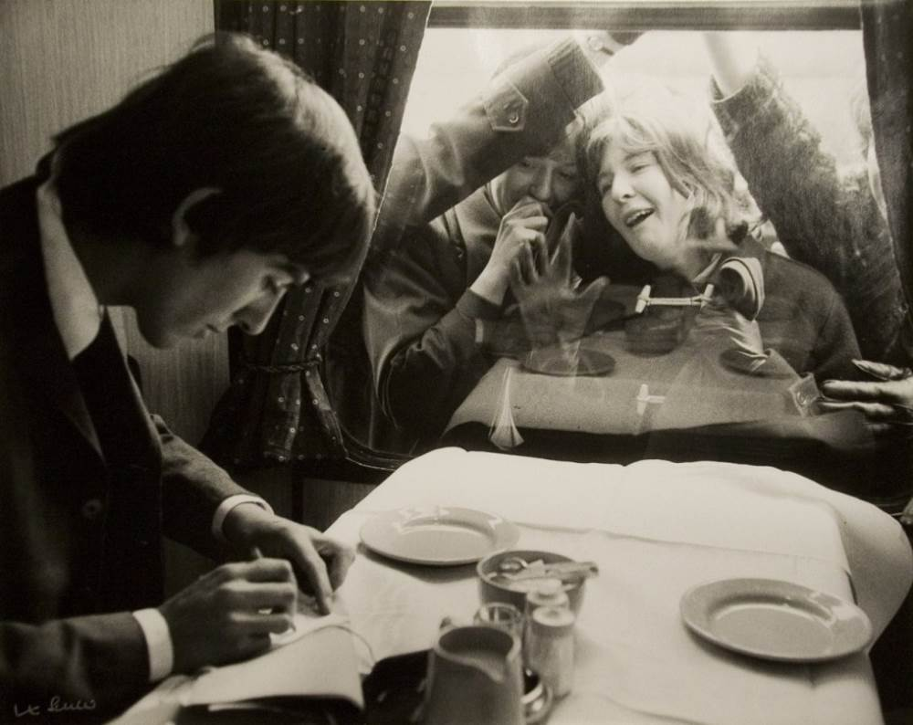 George Harrison Writes Autographs
