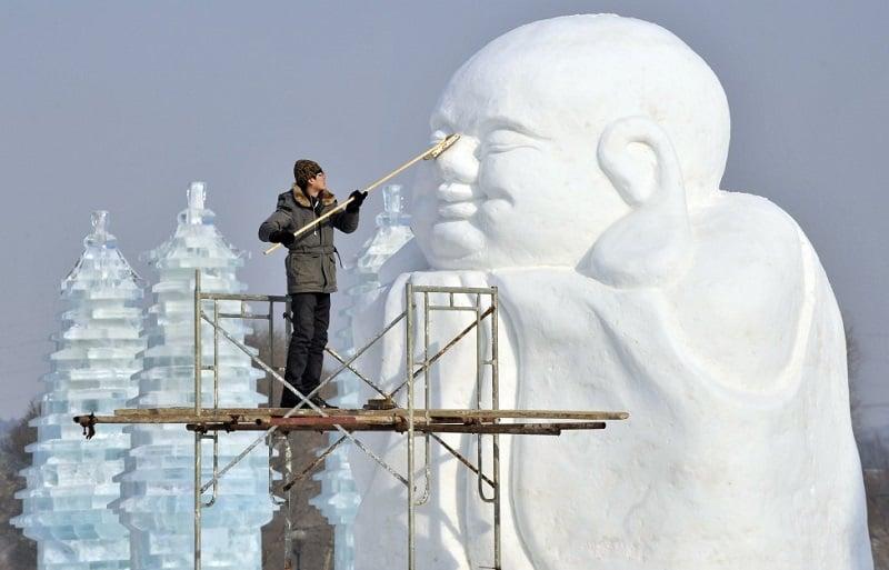 Harbin Artist Sculpting Ice Buddah