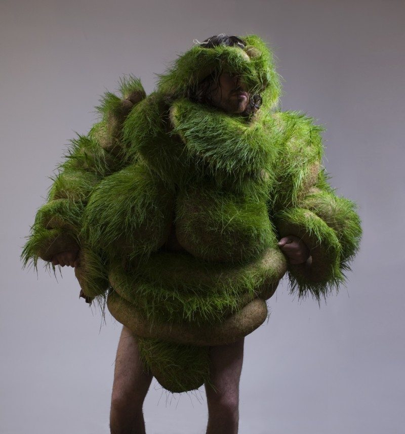 Man Covered in Grass