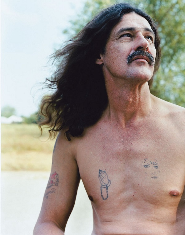 Man With Tattoos and Flowing Hair