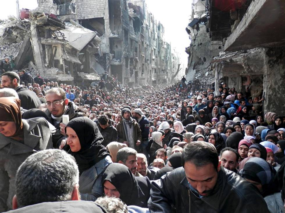 The Queue For Food At A Syrian Refugee Camp