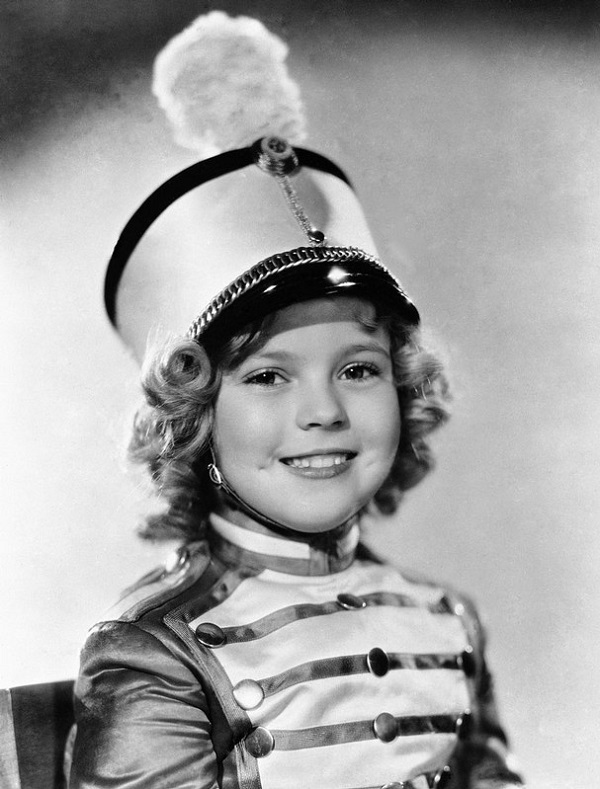 Child Actress Wearing Conductor's Hat