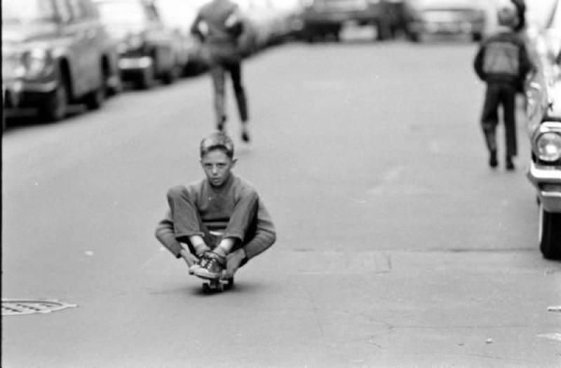 Skateboarding Kids Sitting