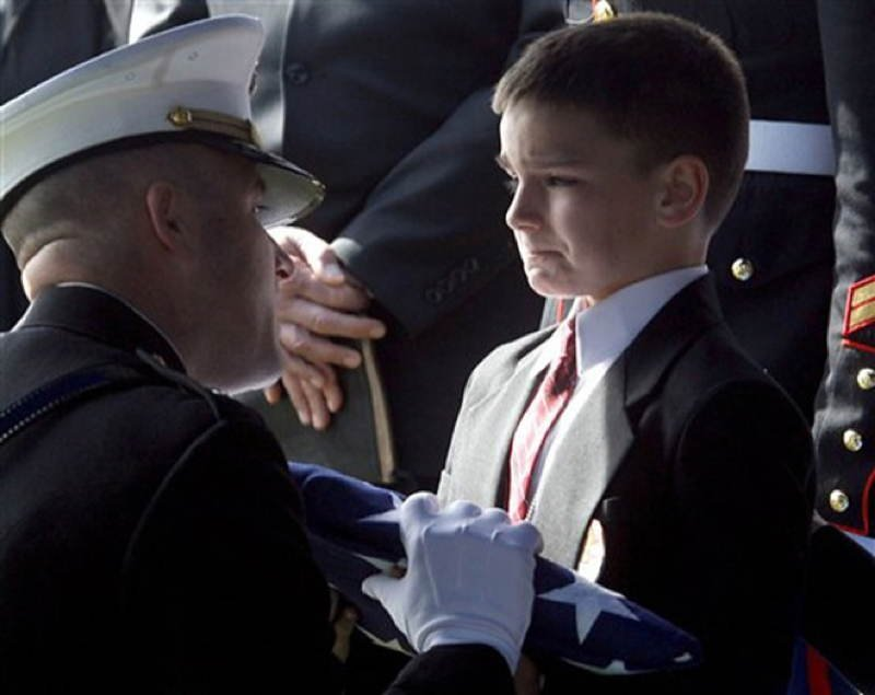 Child Attends Funeral Of His Dad