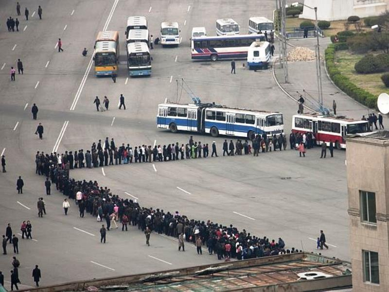 North Korea Photographs Line For Buses In North Korea