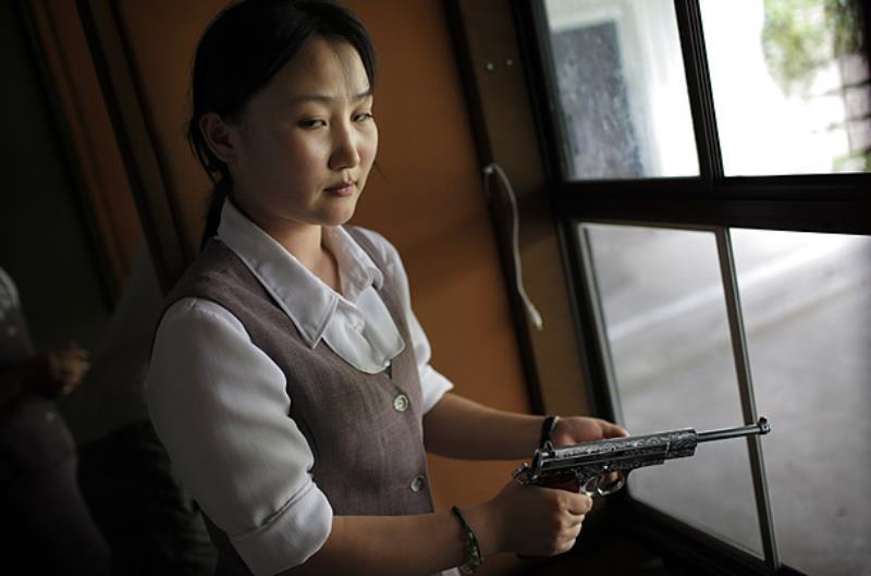 North Korean Woman With Gun