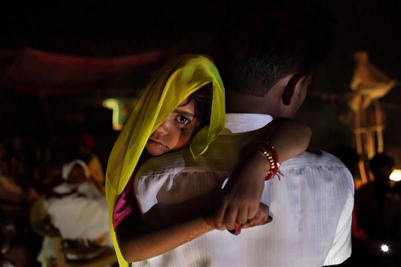 India Man Carrying Bride