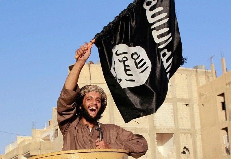 ISIS Member Waves Flag