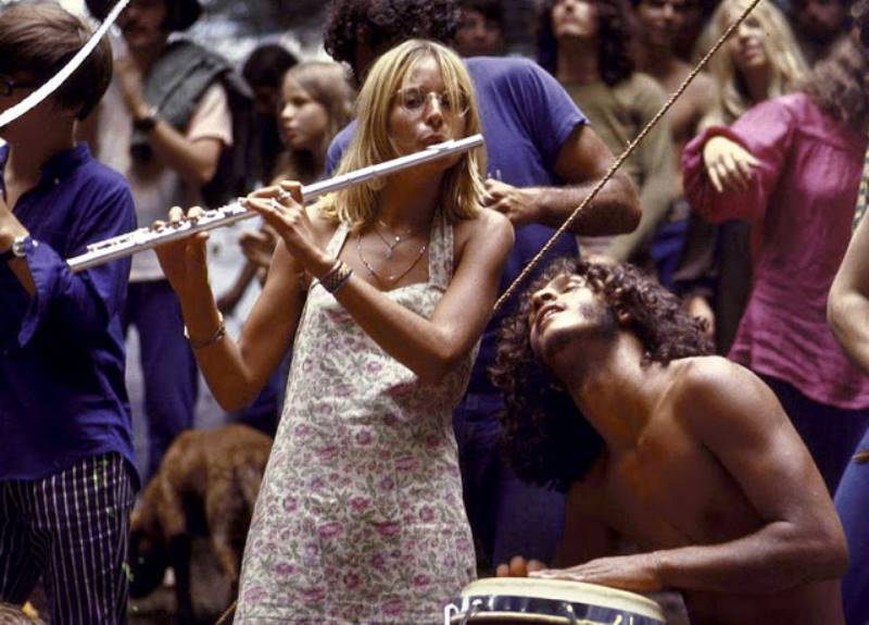 Hippie Woman Playing The Flute