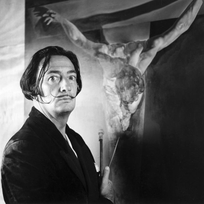 Salvador Dali In Front Of A Crucifixion