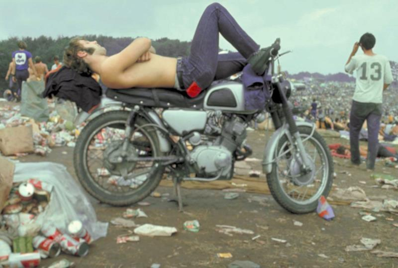 46 Years Ago Today, 500,000 People Descended On A Farm For The Greatest Music Festival Of All Time Sleeping-on-a-motorcycle