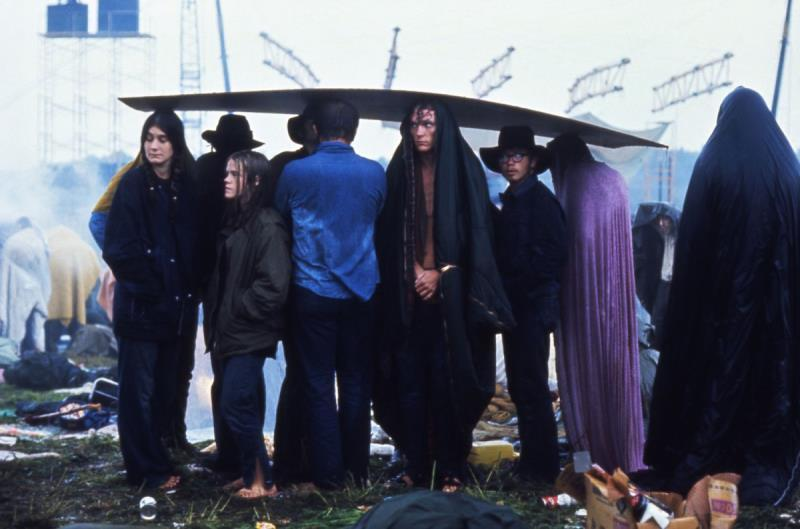 46 Years Ago Today, 500,000 People Descended On A Farm For The Greatest Music Festival Of All Time Waiting-out-the-rain