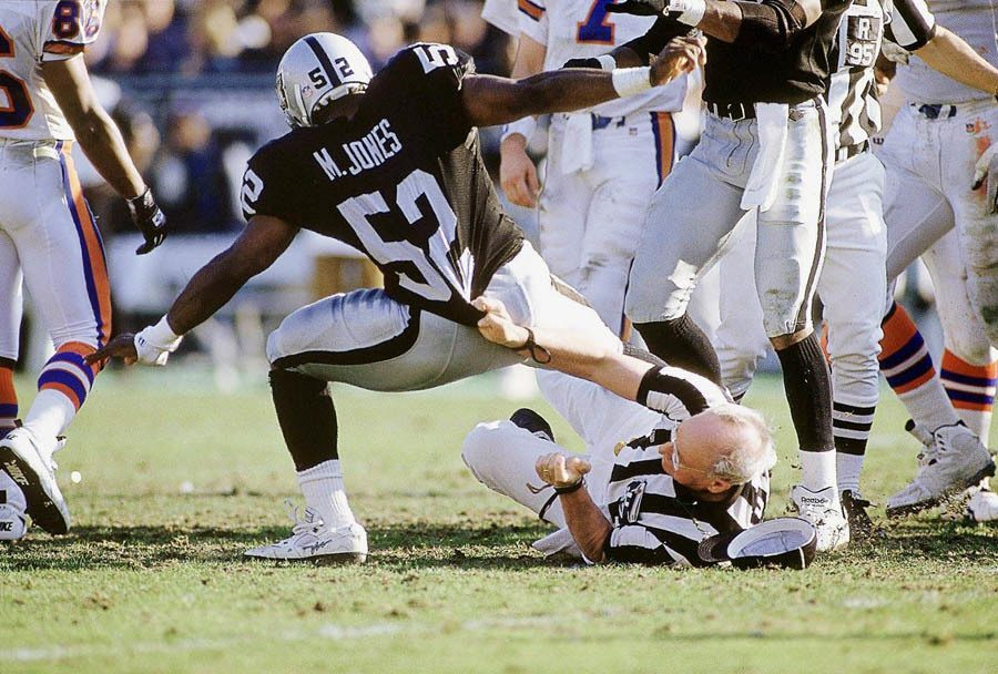 NFL Photos Ref Tackle