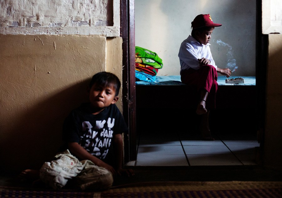 Indonesian Child Smokers Brother Looks On