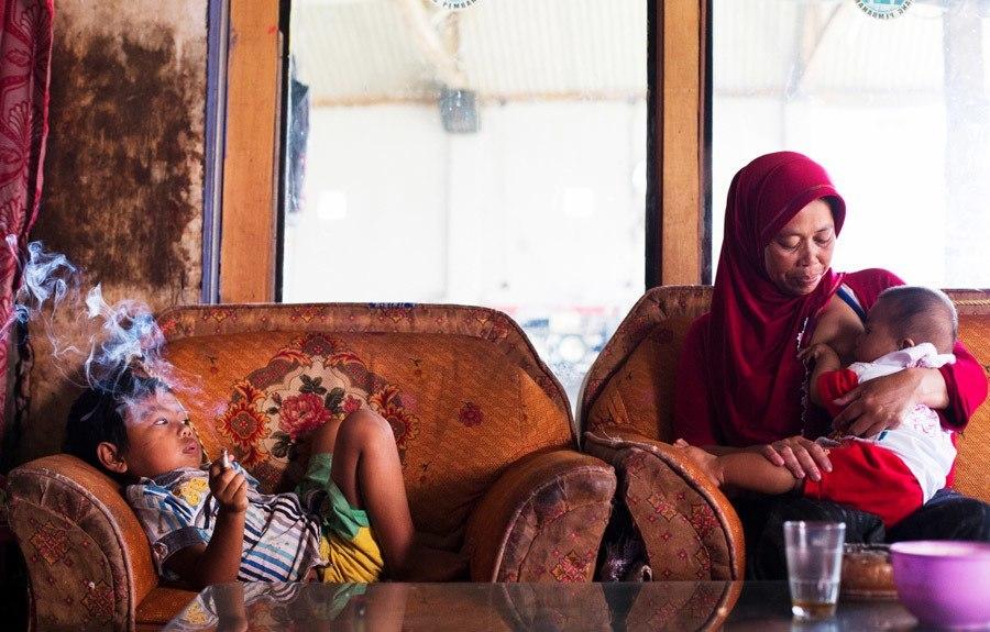 Indonesian Child Smokers Orange Chair