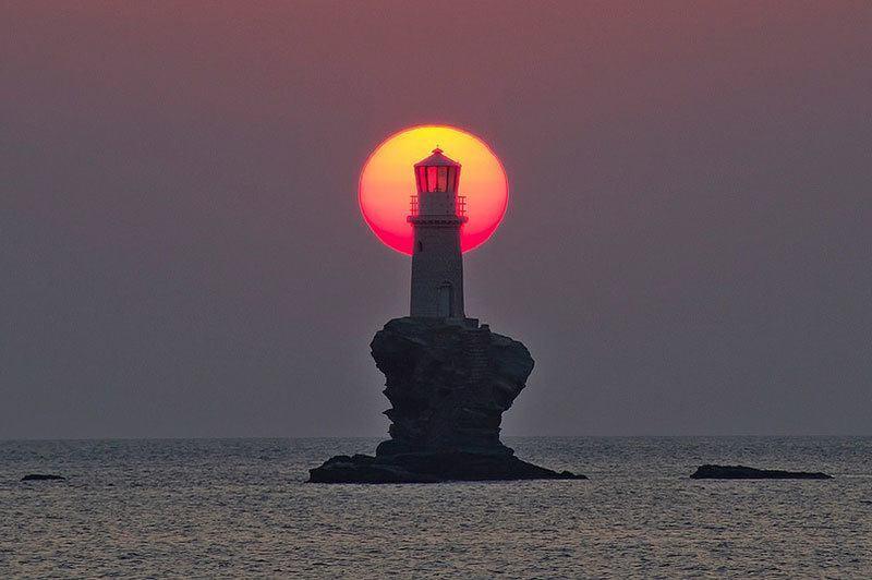 Sun Behind Lighthouse
