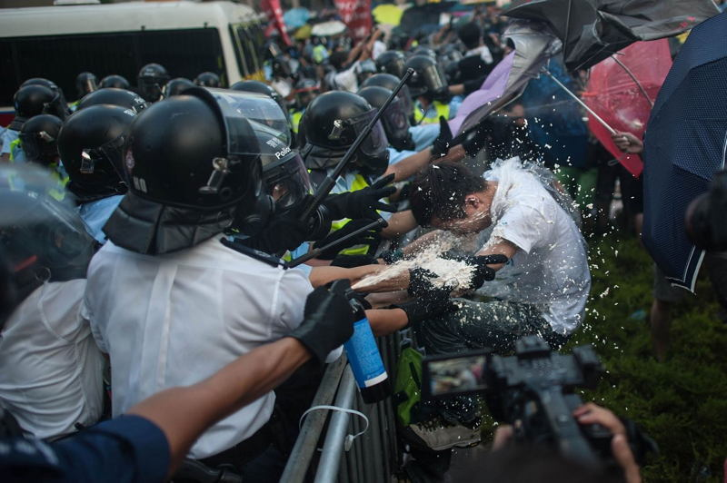 Hong Kong Protests Spray Action