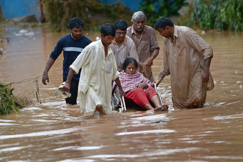 India Pakistan Floods Wheelchair