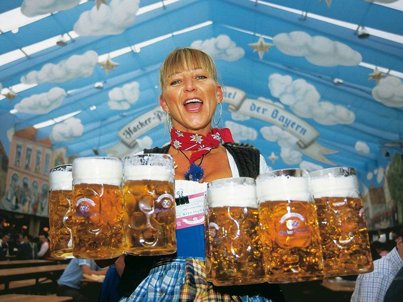 Waitress Carries Beer Steins