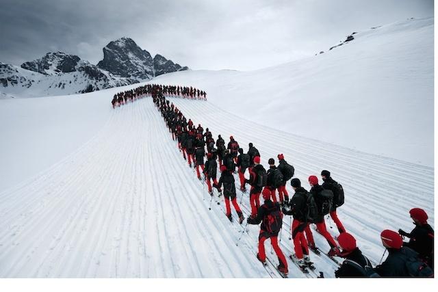Climbers form an arrow on the Matterhorn.