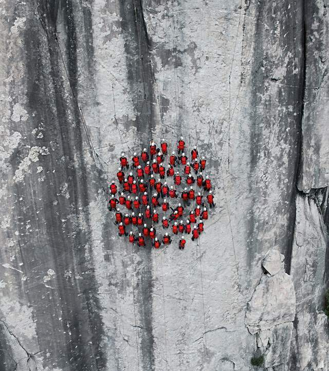 Climbers circle on Matterhorn cliff.