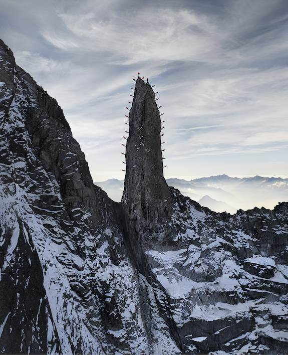 Climbers On Spire In Swiss Alps.