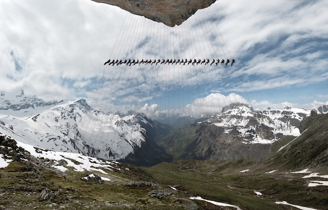 Climbers suspended from cliff on the Matterhorn.