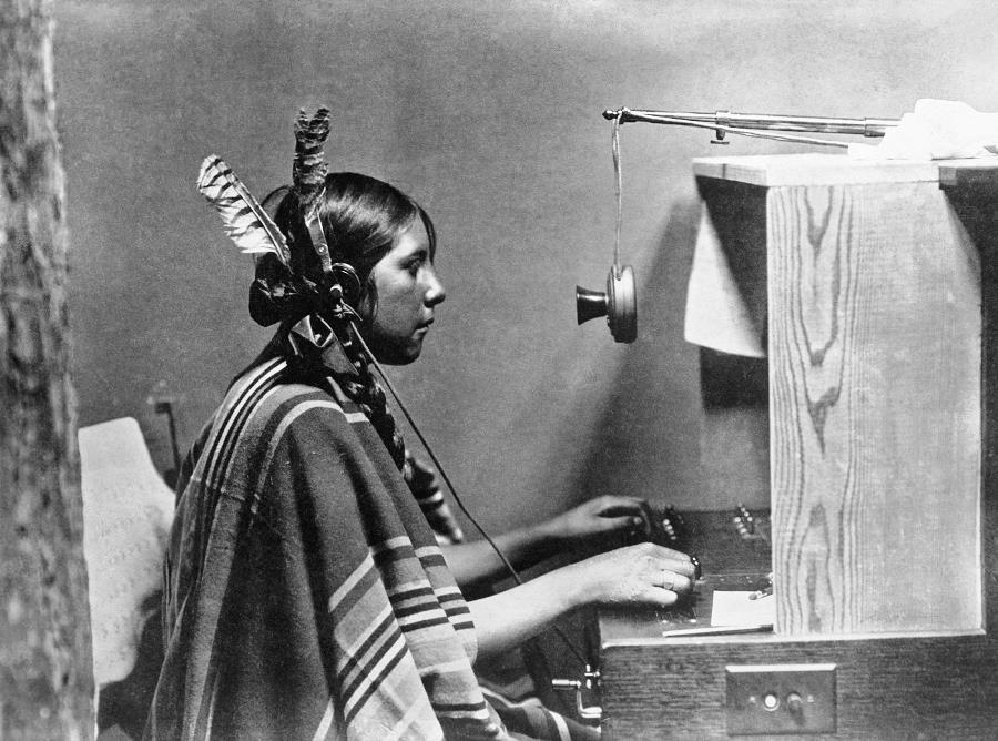 A Native American Woman Operates A Switchboard In 1925