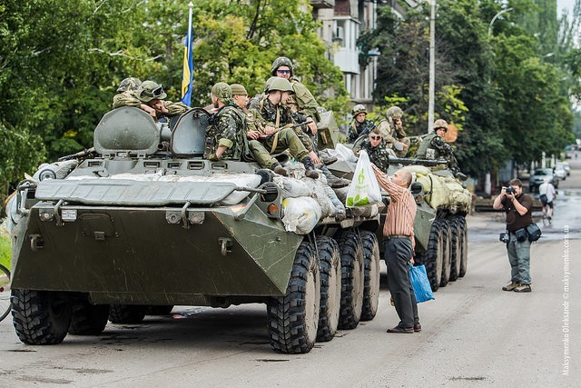 Citizens Giving Food To Ukrainian Militia.