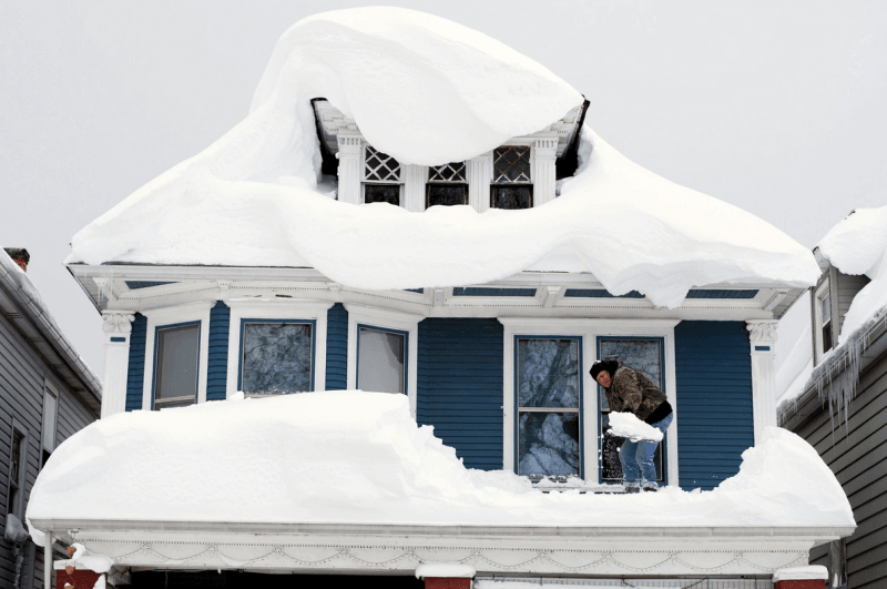 Massive snowfalls pile up on a roof in Buffalo.