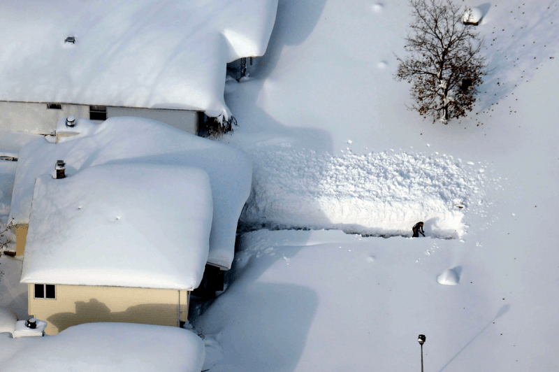 Man shovels out massive snowfall in Buffalo, NY.