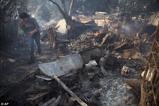 Woman Examines Her Destroyed Home In Donetsk, Ukraine.