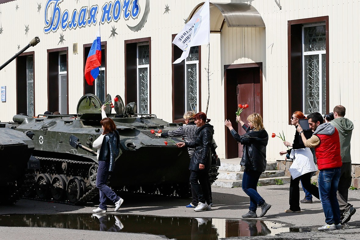 Ukrainian Citizens Place Flowers On Russian Tank.