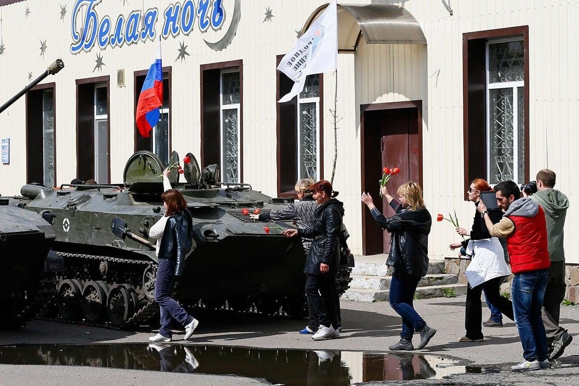 Ukrainian Citizens Place Flowers On Russian Tank.