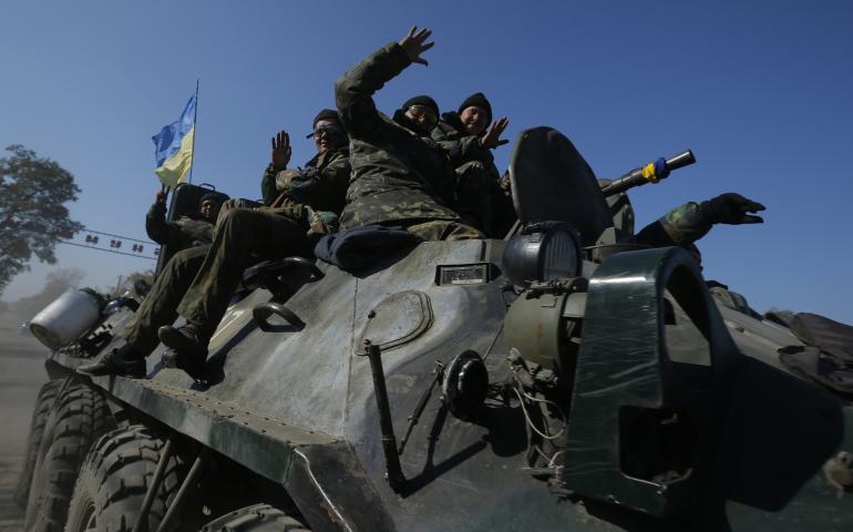 Ukrainian Militia On Armored Vehicle.