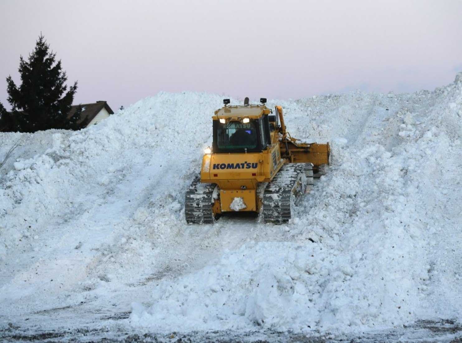 Bulldozer attempts to clear snow in Buffalo, NY.