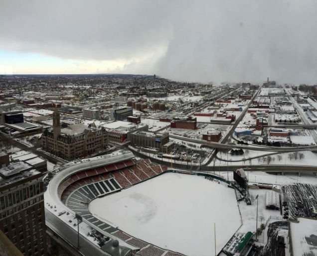Snow covering a baseball stadium in Buffalo.