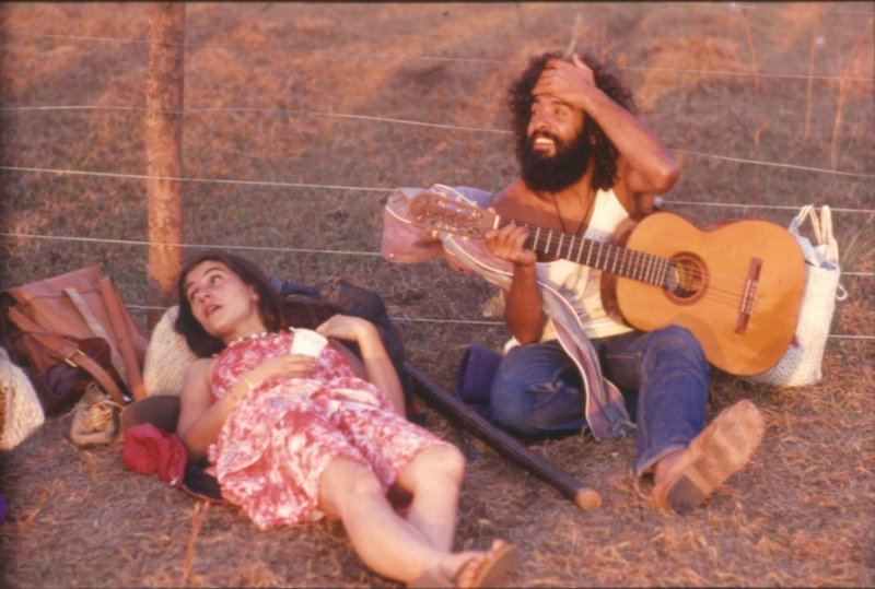 Hippie Playing Guitar At A Commune