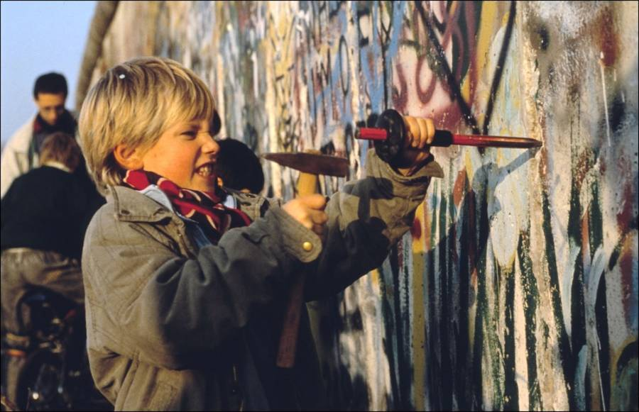 Kid Tries To Hammer Through Berlin Wall