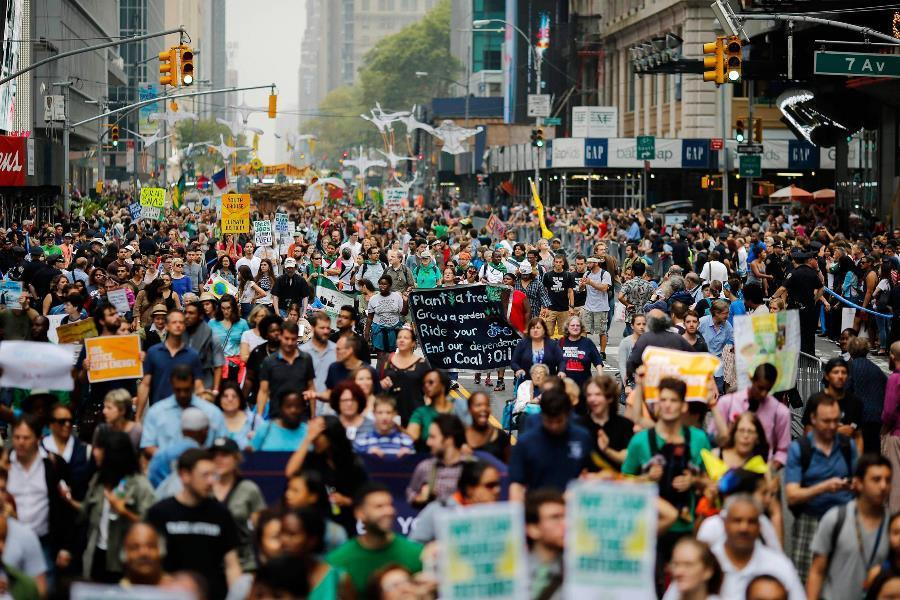 Protestors March During Climate Summit 2014