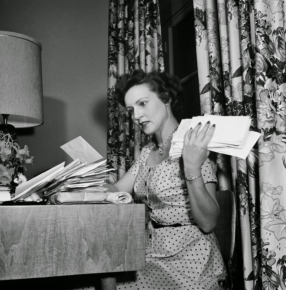 Betty White checking the mail in this vintage photo