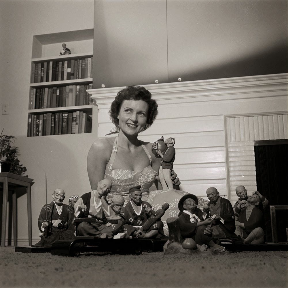 Betty White with Japanese figures