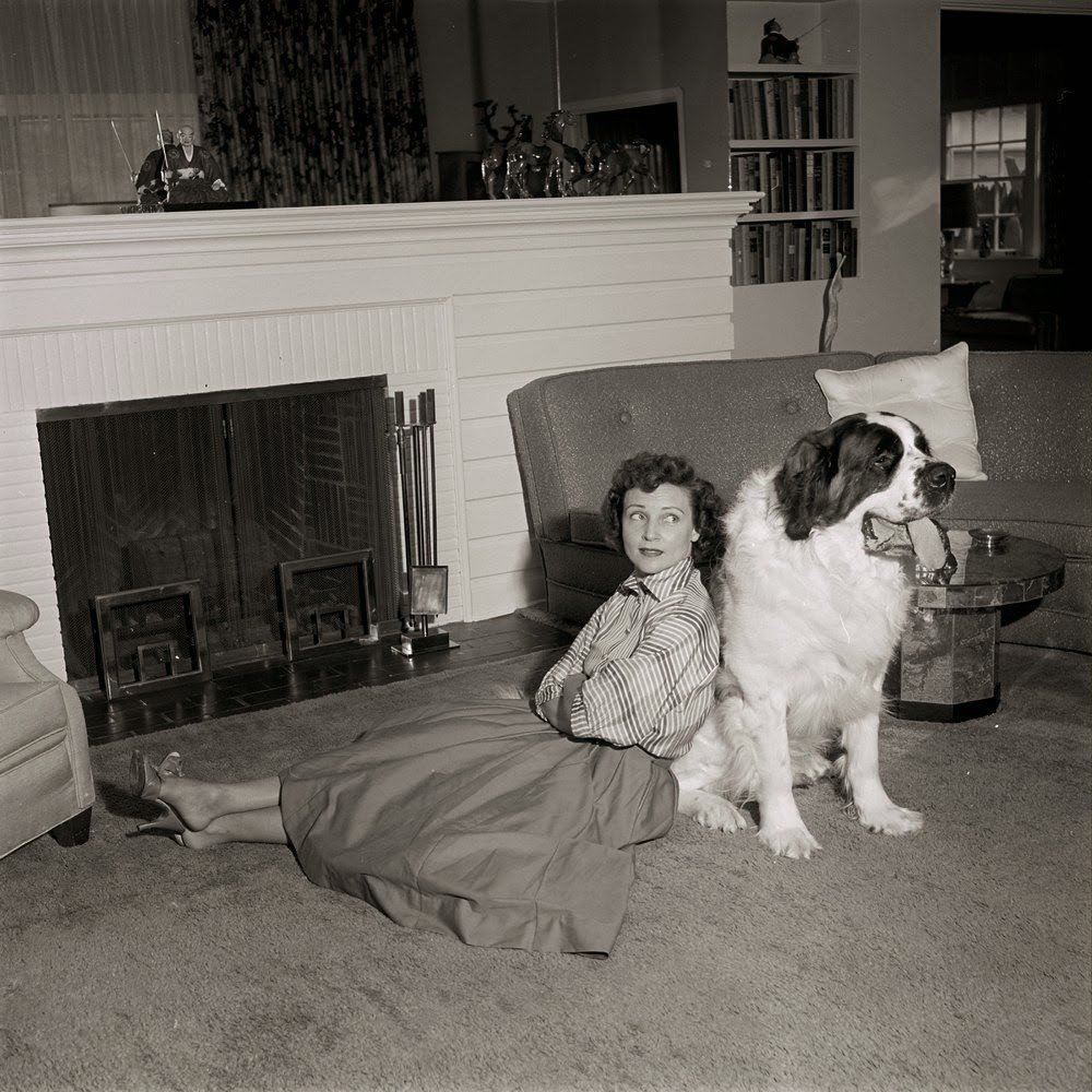 Betty White relaxing with dog