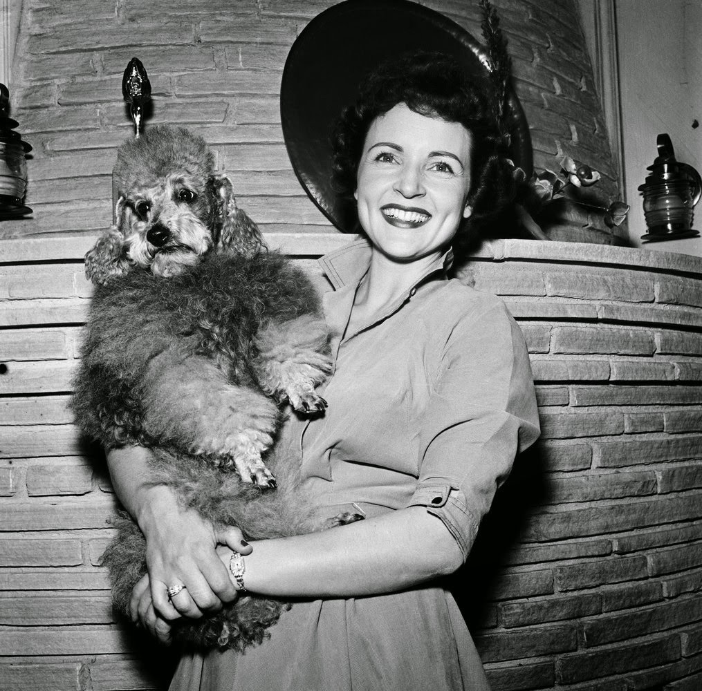 Betty White vintage photo holding a poodle